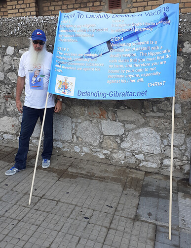 Tony Farrell with his Big Blue Banner about Vaccines