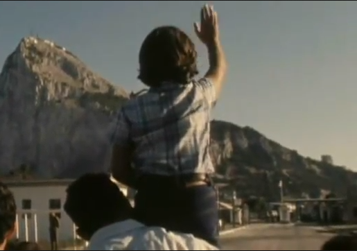 Boy waves to family